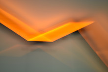 Abstract Orange And Gray Fluorescent Light Background Motion Blur Effect