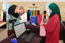 Muslim Women Shopping In A Clo...