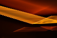 Abstract Black And Orange Fluorescent Light Background Motion Blur Effect