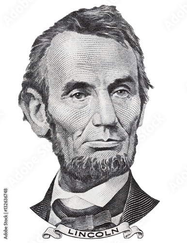 Fotografiet  US president Abraham Abe Lincoln face portrait on USA 5 dollar bill closeup isolated, United States of America money close up