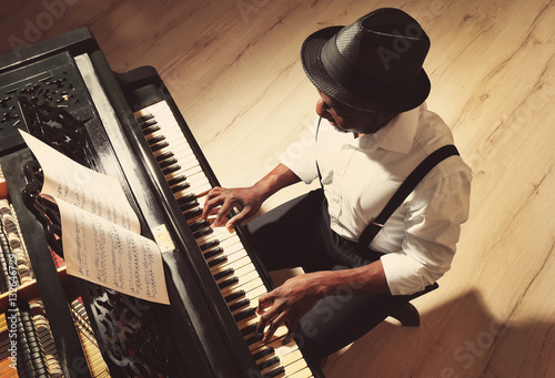 Afro American man playing piano