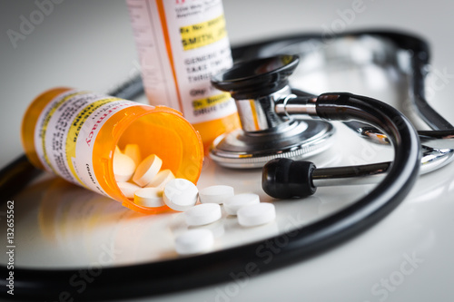 Photo  Non-Proprietary Medicine Prescription Bottles and Spilled Pills Abstract with Stethoscope