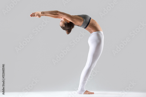 Young attractive woman practicing yoga, doing Standing Backward Bend exercise, A Canvas Print
