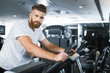 Sporty bearded man in gym