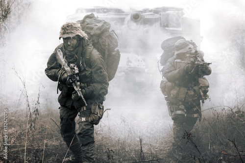 Fényképezés  Jagdkommando soldiers Austrian special forces and tank moving on terrain in the fog