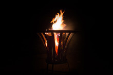 Burning Piece Of Wood In A Fir...