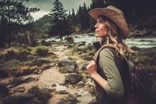 Beautiful Woman Hiker Enjoying Amazing Landscapes Near Wild Mountain River