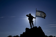 Soldier On Top Of The Mountain With The Israeli Flag