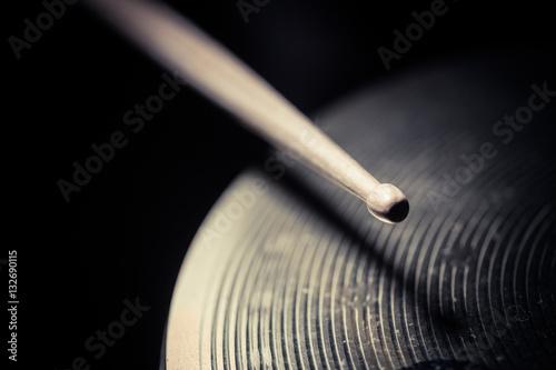 Obraz na plátne Close up shot of a drumstick hitting a cymbal.