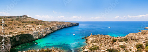 Clear turquoise water of popular tourist attraction on Malta Wallpaper Mural