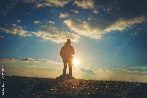 silhouette of Traveler man at sunset Poster