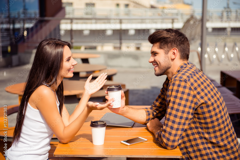 Fototapety, obrazy: Young couple having date in cafe, drinking coffee  and talking