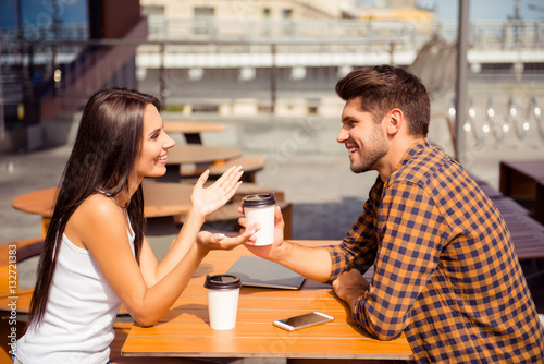 Valokuva  Young couple having date in cafe, drinking coffee  and talking