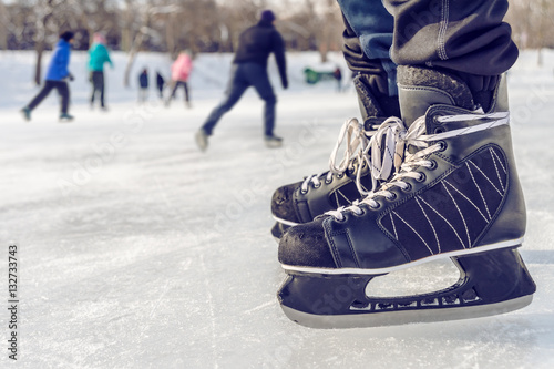 Close-up of ice skating shoes on a rink