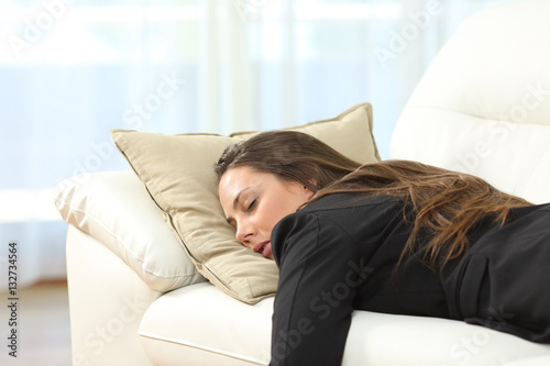 Obraz Tired executive sleeping at home after work - fototapety do salonu