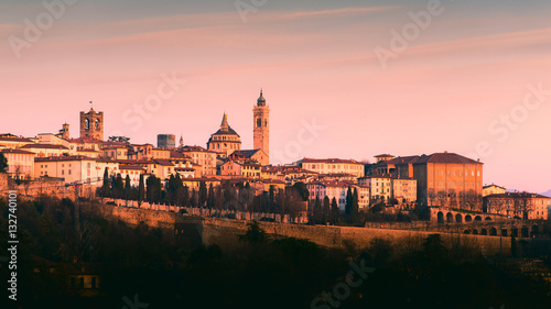Fotografiet Bergamo Alta old town colored af sunset's lights - Lombardy Italy