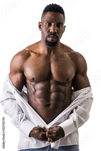 672842d316 African American bodybuilder man, wearing jeans and open shirt on naked  muscular torso, isolated on white background