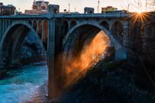 Sun Shining Through Steam Under The Monroe Street Bridge In Spokane