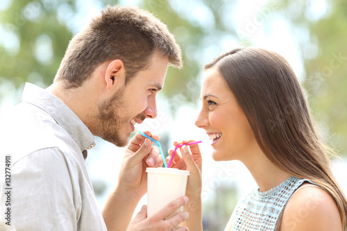 Foto op Plexiglas Milkshake Couple in love sharing a drink