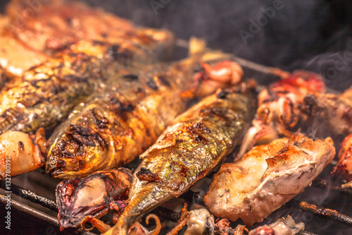 Tuinposter Grill / Barbecue beside the street a small restaurant bbq sea food and pork for sale to tourist