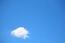 Single Cumulous Cloud On A Blue Sky