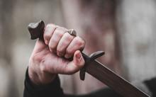 Sword In The Man's Hand