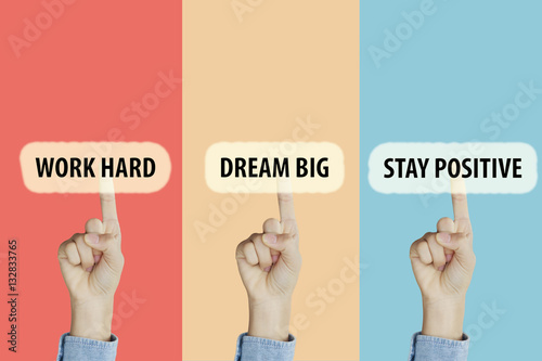 Photo  Hands fingers pointing with index fingers to Work Hard,Dream Big