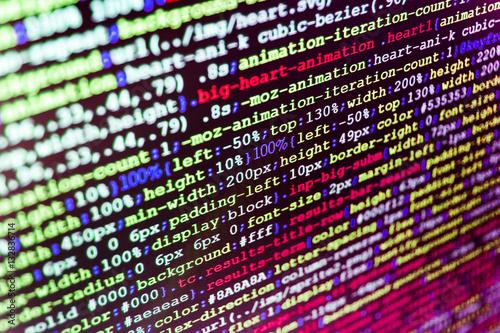 Writing programming code on laptop  Binary digits code