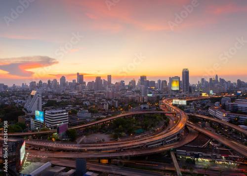 Poster Bangkok Bangkok Cityscape, business district with expressway , freeway and motorway , an important infrastructures in Bangkok at night ,Bangkok,Thailand