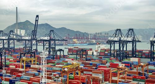 Tuinposter China HONG KONG -MAY13: Containers at Hong Kong commercial port on May 03, 2013 in Hong Kong, China. Hong Kong is one of several hub ports serving more than 240 million tonnes of cargo during the year.