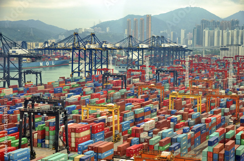 Poster de jardin Chine HONG KONG -MAY13: Containers at Hong Kong commercial port on May 03, 2013 in Hong Kong, China. Hong Kong is one of several hub ports serving more than 240 million tonnes of cargo during the year.