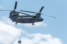 Double Rotor, Heavy Airlift, Military Helicopter, In Flight, Carrying Cargo.