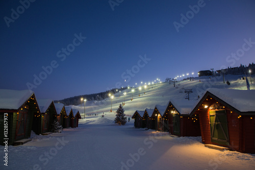 winter market village in Levi, Finland in the evenig on ski cable way background Tableau sur Toile