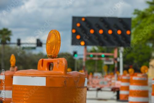 Fotografie, Obraz  Road closed signs detour traffic temporary street work orange lighted arrow and