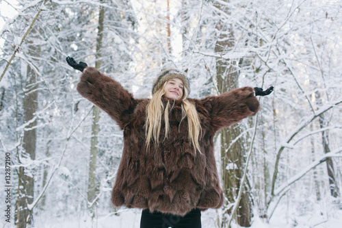 Happy woman dressed in warm clothes