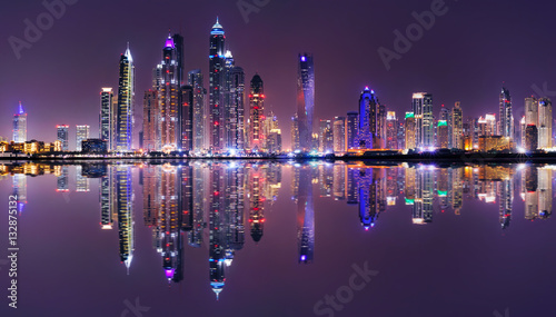 Amazing night panorama of Dubai Marina. Multiple highest skyscrapers of the world with residential buildings, Dubai, United Arab Emirates