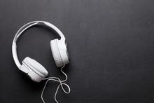 Headphones On Leather Desk Table