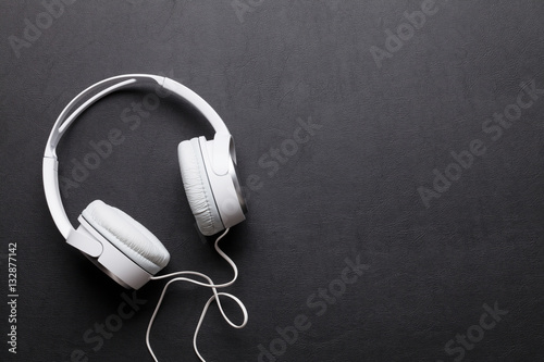 Fotografie, Obraz  Headphones on leather desk table