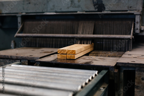 Wood emerging from cutting machine - 132881902