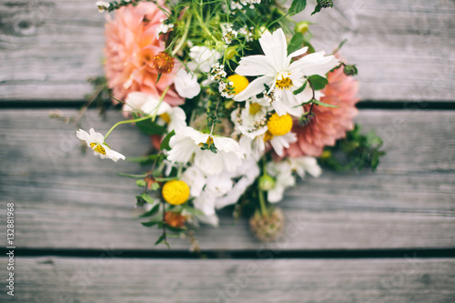 Bunch of flowers on a wooden table