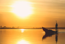Pirogue At Sunset