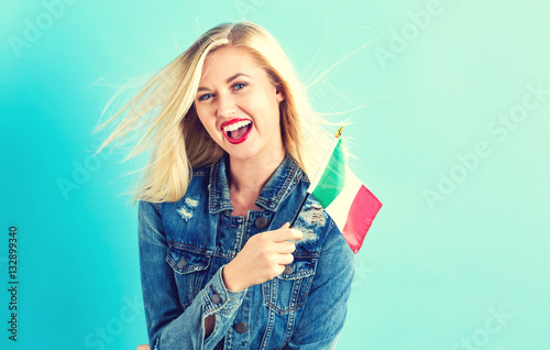 Fotografie, Obraz  Young woman holding Italian flag