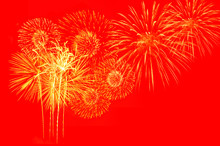 Gold Fireworks On Red Background.