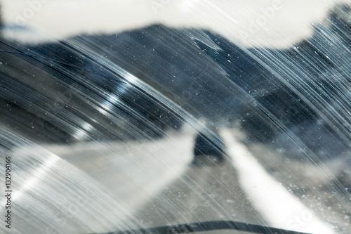 Fotografie, Obraz  Windshield smeared in an arc by a windshield wiper