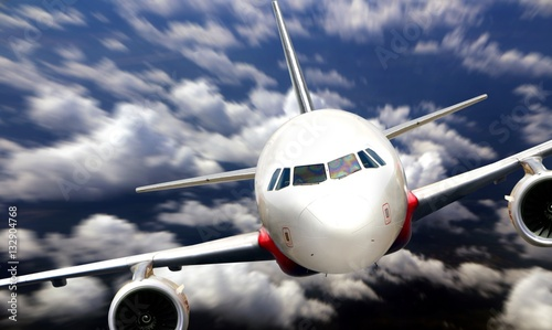 Airplane flying from nose view Canvas Print