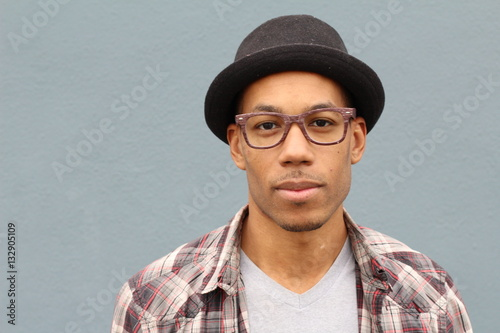 Photographie  Hip man wearing a Fedora hat with copy space
