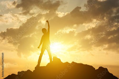 Canvastavla Man on the peak of mountain and sunrise or sunset background lan