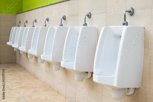 Fotografía  row of outdoor urinals men public toilet,Closeup white urinals i