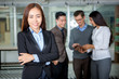 Successful Asian businesswoman with colleagues