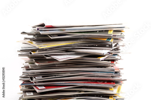 Fotografia Stack or pile of old subscription magazines against white background